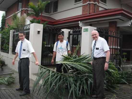 Clearing Palm Leaves after Typhoon passed by - Elder Hale, Danny and Elder Breese