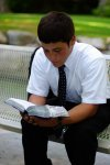 Elder Astle reading his scriptures