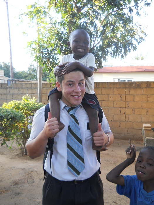Elder Astle giving a members child a ride